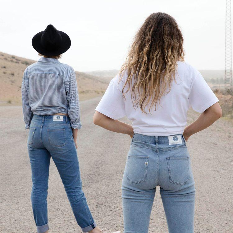Two women wearing Mud Jeans